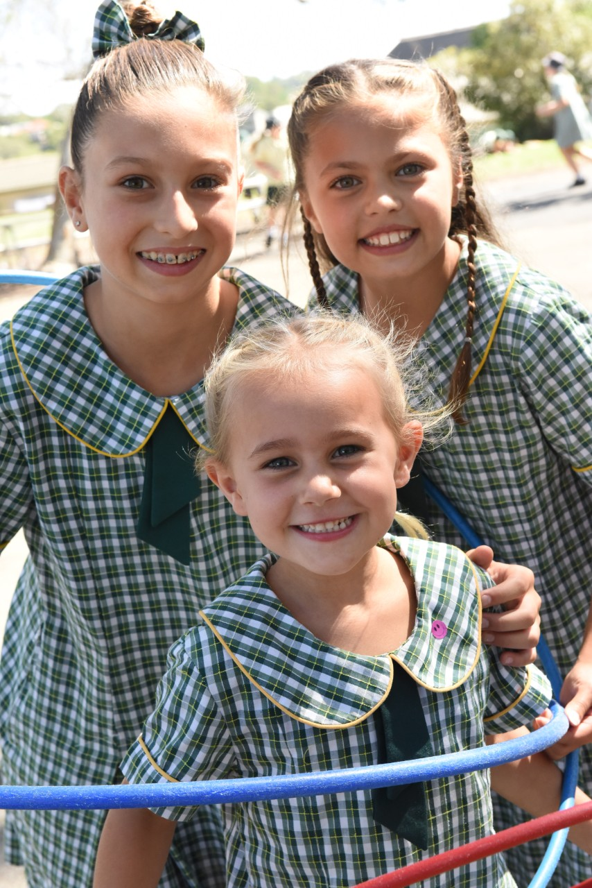 Students smiling in their uniform.